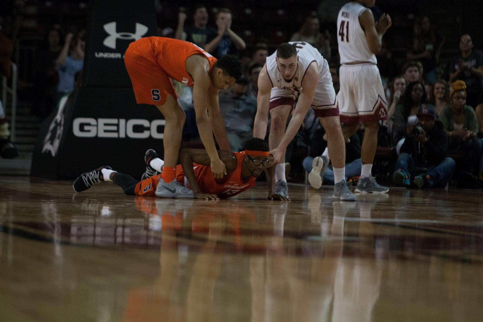 Paschal Chukwu is helped up off the floor during Syracuse's 85-70 loss to Boston College.