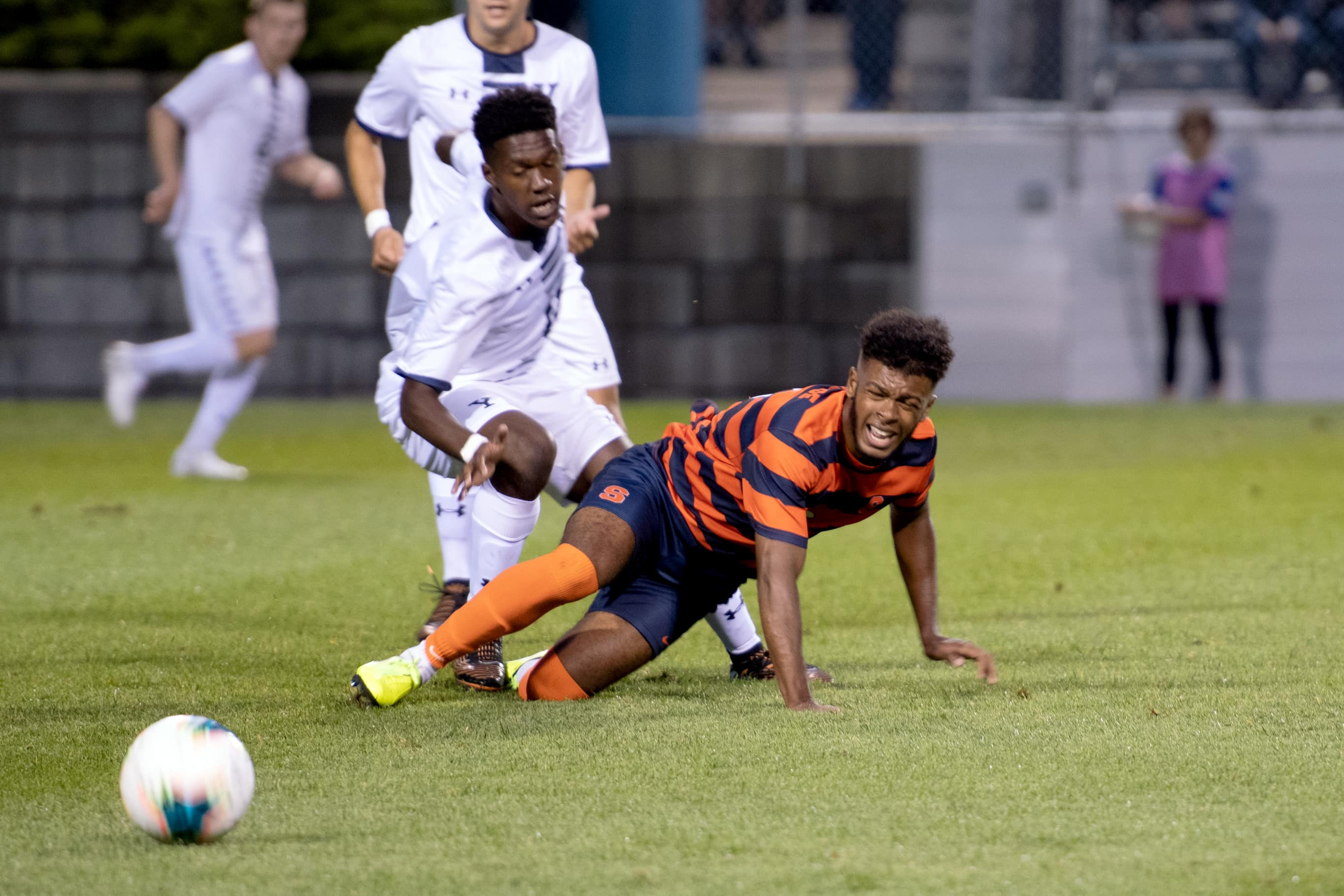 Julio Fulcar falls to the ground going after after a ball against Yale on Friday.