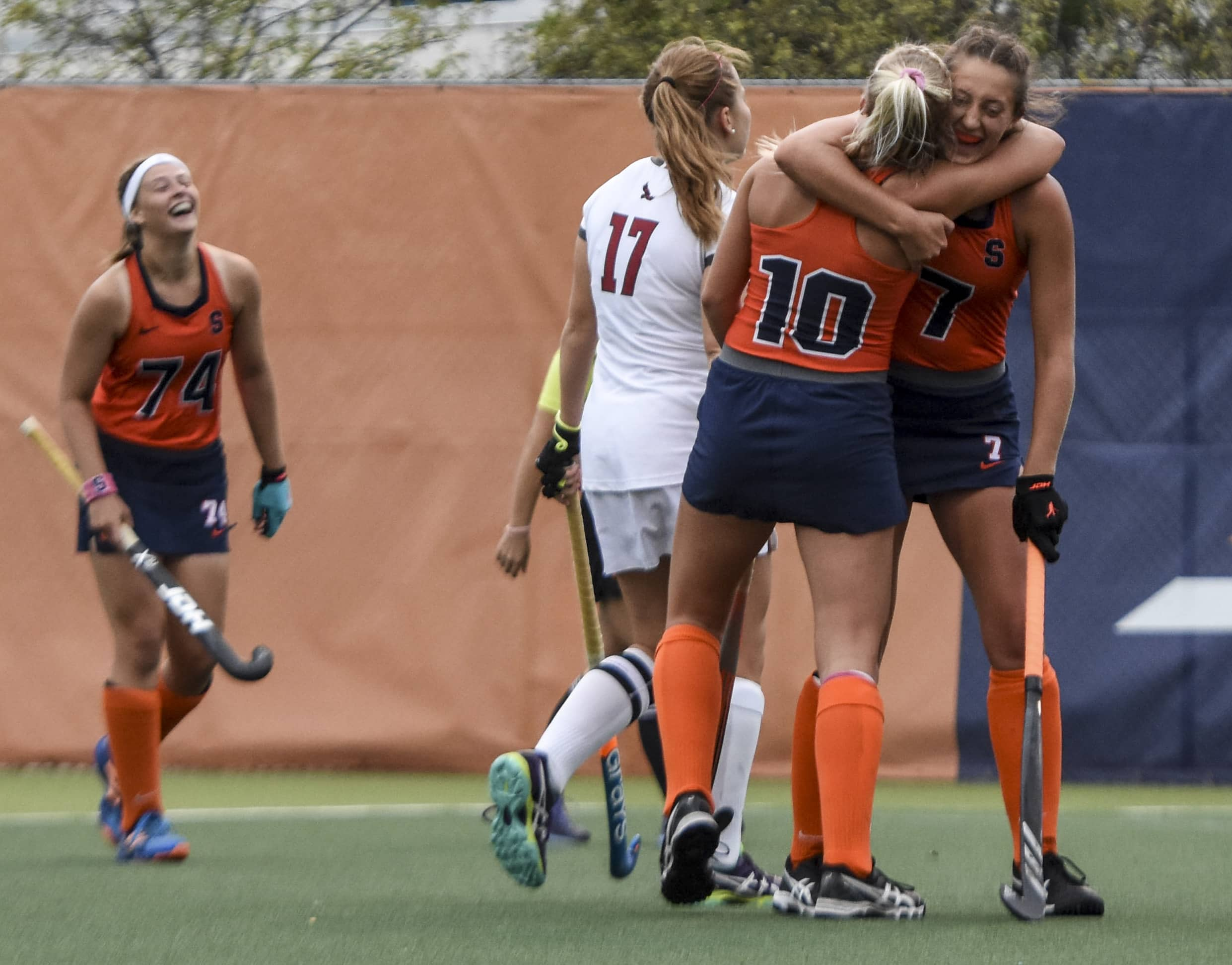 Sarah Luby embraces teammate, forward Charlotte De Vries after scoring