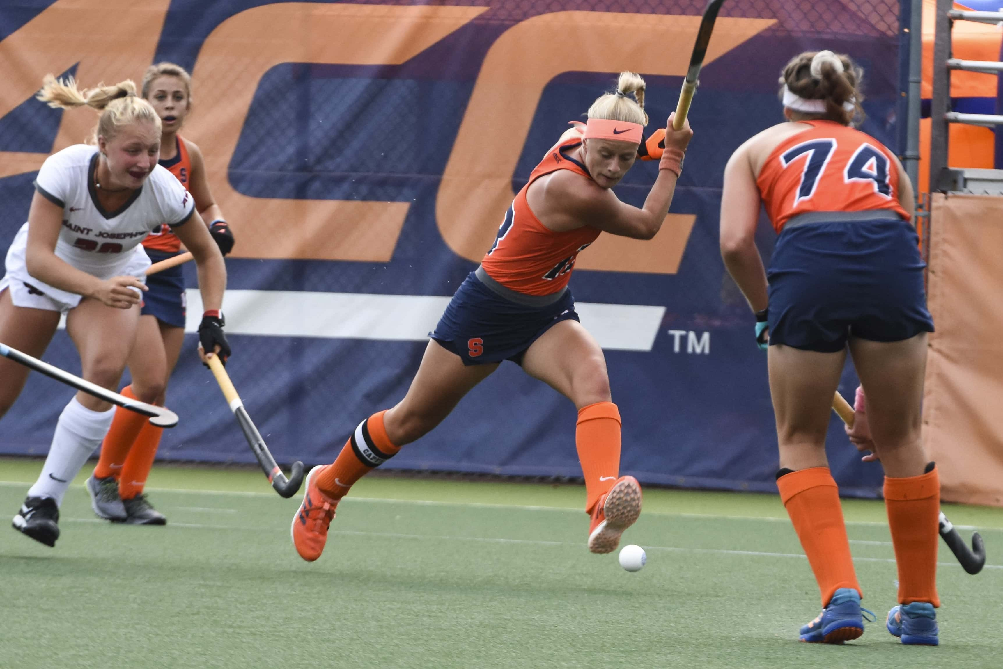 Charlotte De Vries sends the ball across the field for a Syracuse Field Hockey gain.