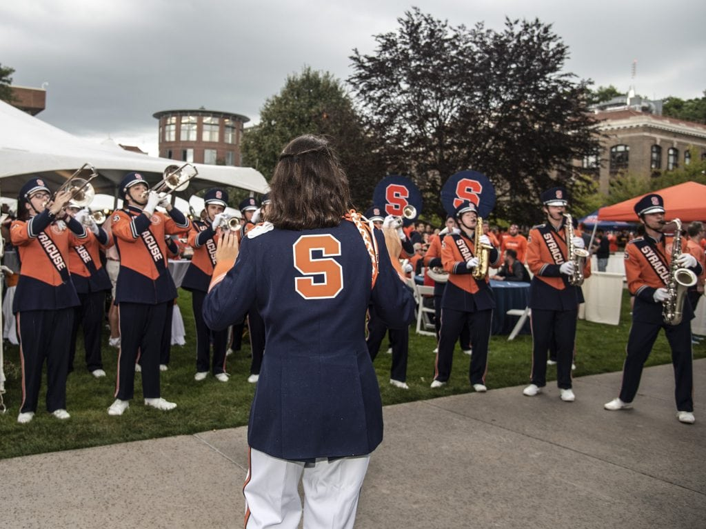 The Syracuse University Marching Band plays for fans, alumni, students and family members at the Orange Central Tailgate