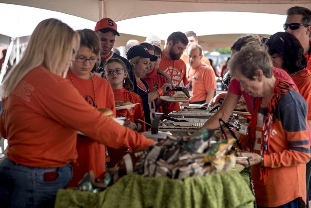 Syracuse University fans, alumni, students and family members grab food at Orange Central Tailgate