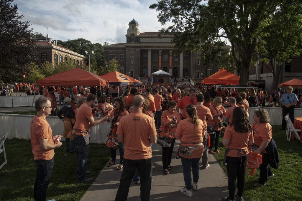Hundreds of Syracuse University fans, alumni, students and family members wait to enter the Orange Central Tailgate before the SU Oranges vs. Clemson Tigers football game.