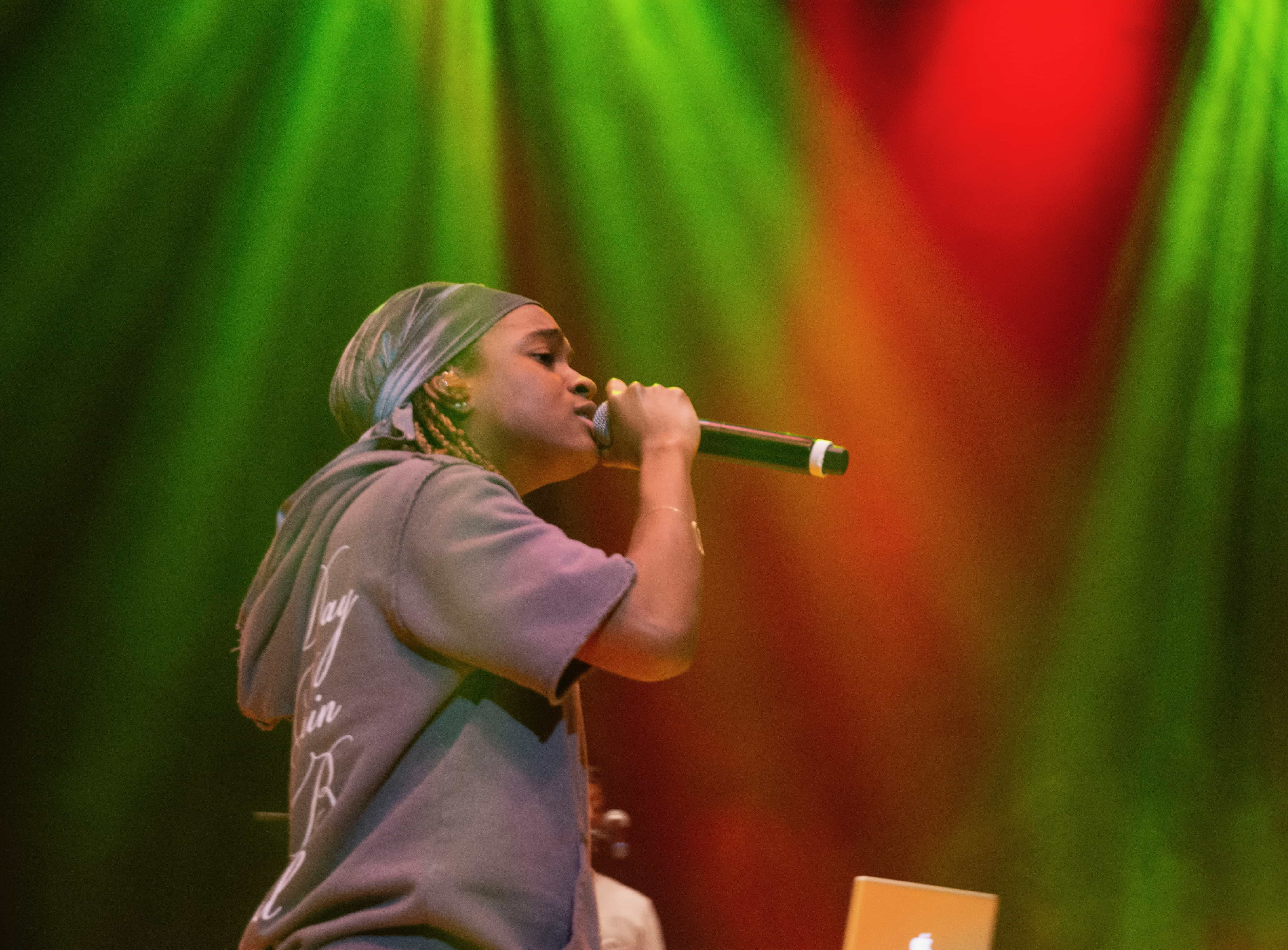 Koffee energizes the crowd under the warm stage lights