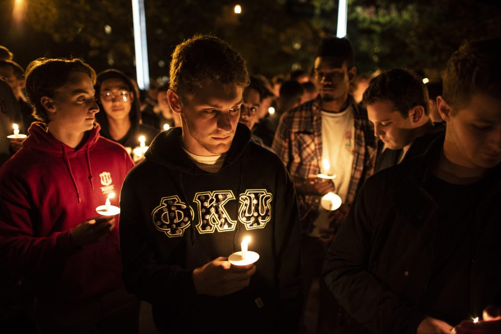 Members of the Phi Kappa Psi Fraternity hold candles at the Safe Driving Vigil sponsored by both Phi Kappa Psi and Delta Delta Delta Monday evening outside Hendricks Chapel.