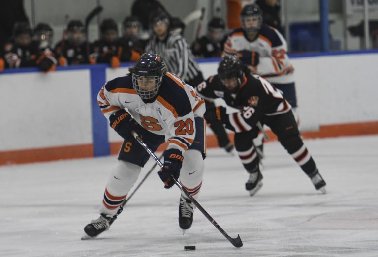 Syracuse's Anonda Hoppner skates with the puck against RIT in November.