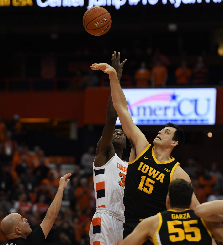 SU's Bourama Sidibe and Iowa's Ryan Kriener jump for the opening tipoff during the ACC/Big Ten Challenge at the Carrier Dome on December 3, 2019.