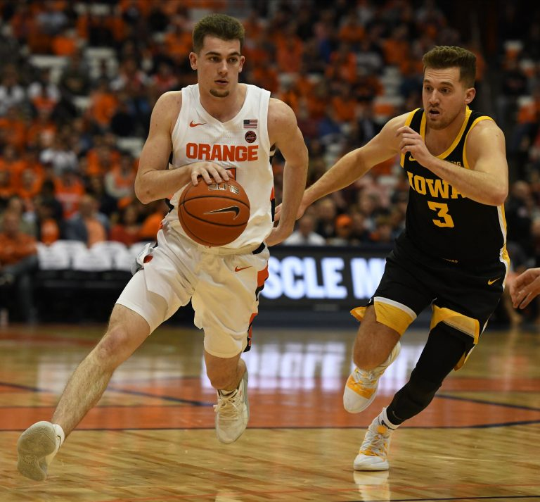 Joseph Girard III drives with the basketball as Jordan Bohannon defends during the ACC/Big Ten Challenge at the Carrier Dome on December 3, 2019.