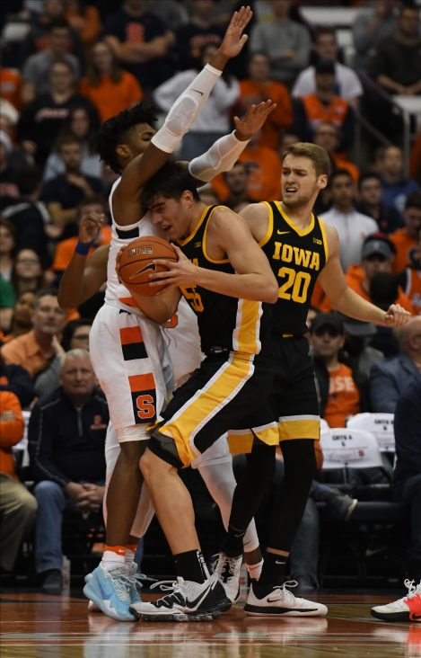 Iowa's Luka Garza drives to the basket as Quincy Guerrier defends during the ACC/Big Ten Challenge at the Carrier Dome on December 3, 2019.