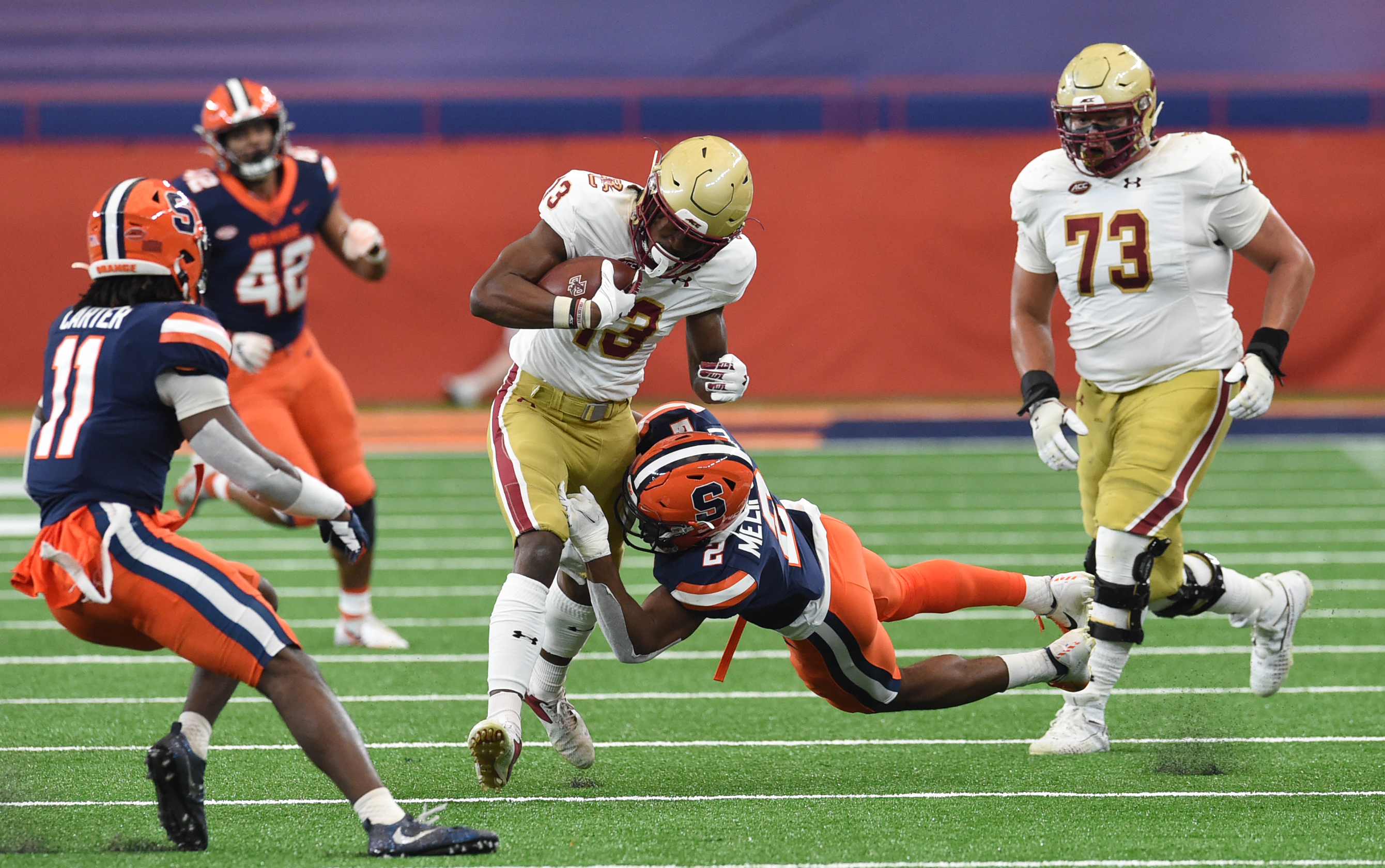 Boston College Eagles wide receiver Jehlani Galloway (13) is tackled by Syracuse Orange defensive back Ifeatu Melifonwu (2) during a game on Saturday, Nov. 7, 2020, at the Carrier Dome in Syracuse, N.Y.