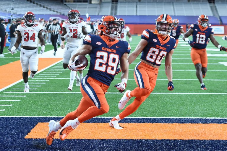 Syracuse Orange wide receiver Trebor Pena (29) runs back a kickoff for a touchdown during a game against North Carolina State on Saturday, Nov. 28, 2020, at the Carrier Dome in Syracuse, N.Y.