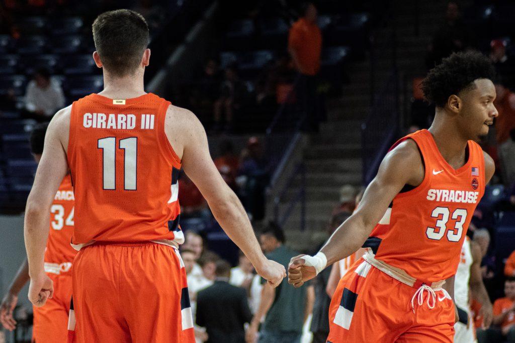 Joe Girard III and Elijah Hughes