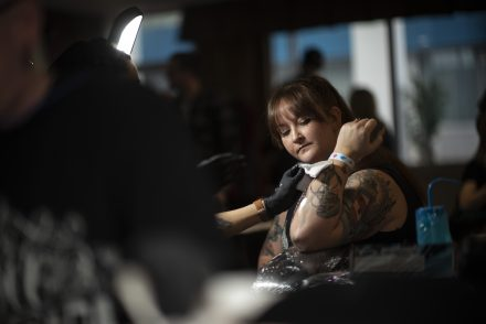 Alyssa Pierce checks her tattoo