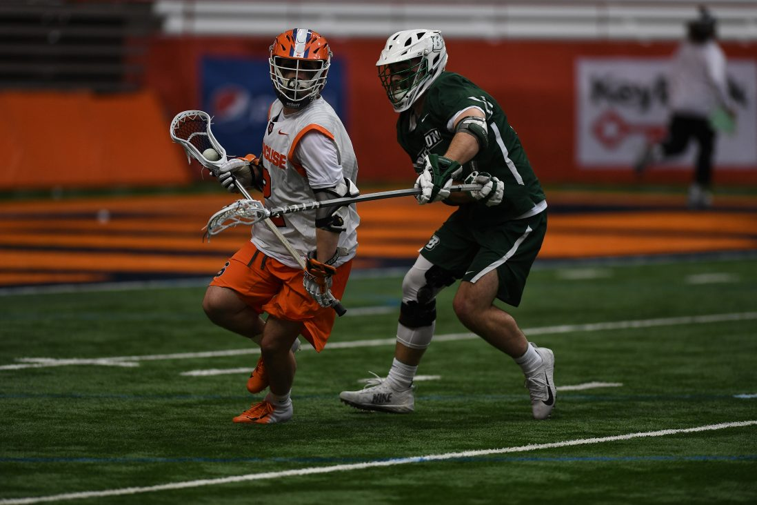 Griffin Cook takes the ball while Binghamton's Tom Galgano defends. Cook had 3 goals in the game.