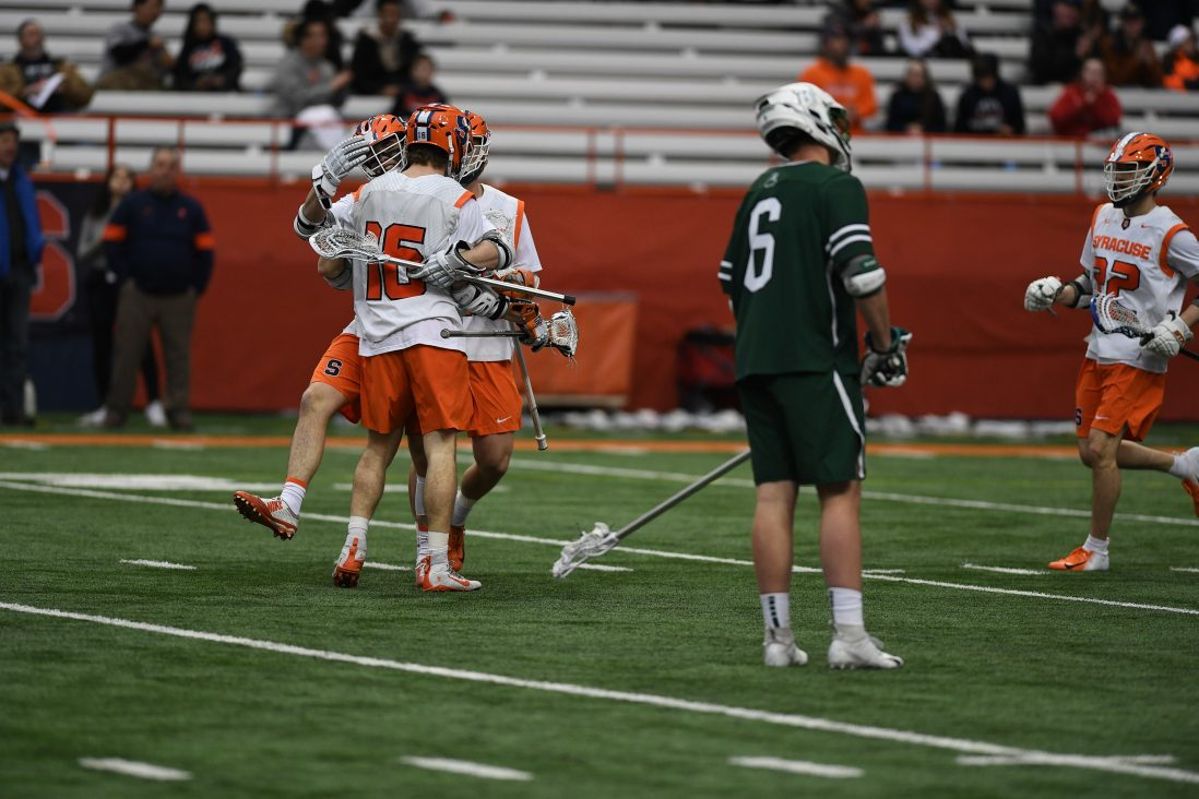 Syracuse players celebrate after scoring.
