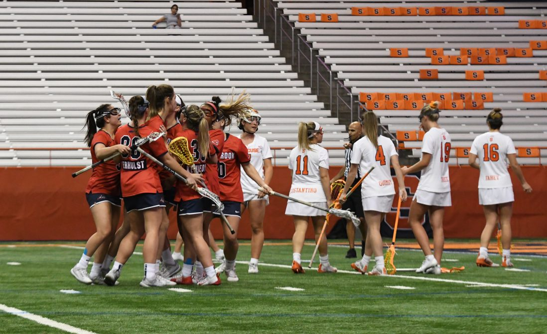 Stony Brook celebrates after a goal. The Seawolves scored 7 unanswered goals in the second half after the Orange tied the game at 9.