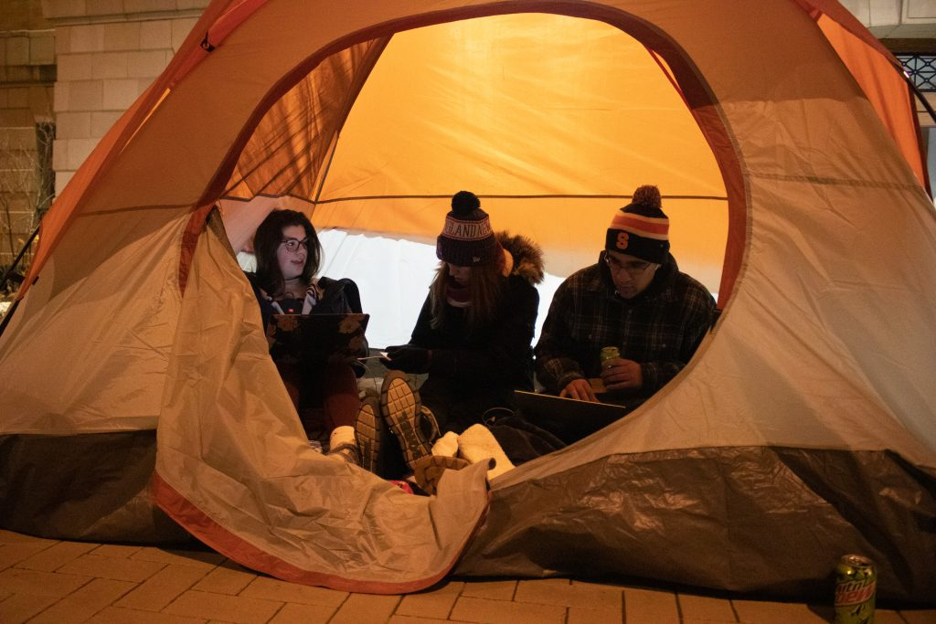 Syracuse freshmen Emma Sheridan, Anna Blackwood, and Chris Bezdedeanu work on homework in their tent during the Carrier Dome Camp Out before the Syracuse Men's basketball game against Duke on the night of January 31, 2020.