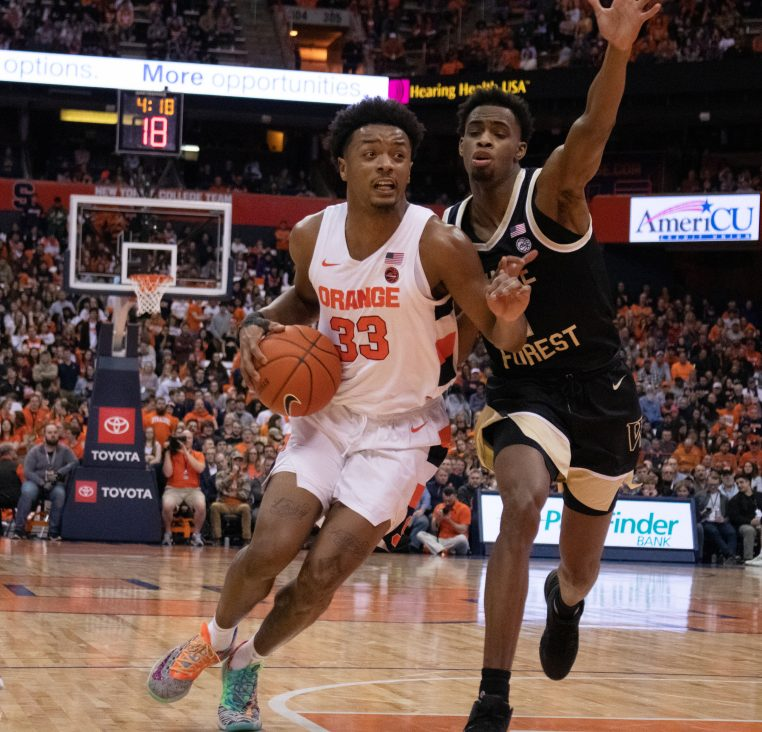 Syracuse University's forward Elijah Hughes, 33, drives the ball down the court during the first half of a college basketball game against Wake Forest.