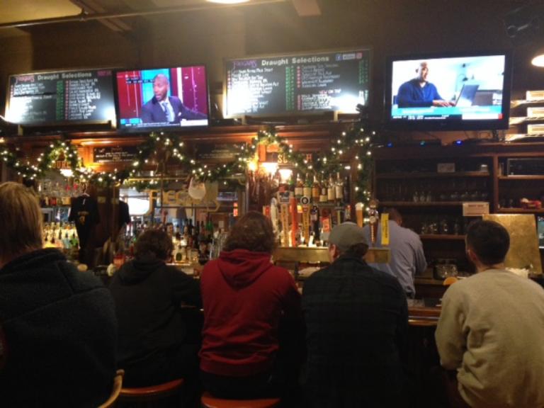 Customers talk and await their drinks at Faegan's Pub.