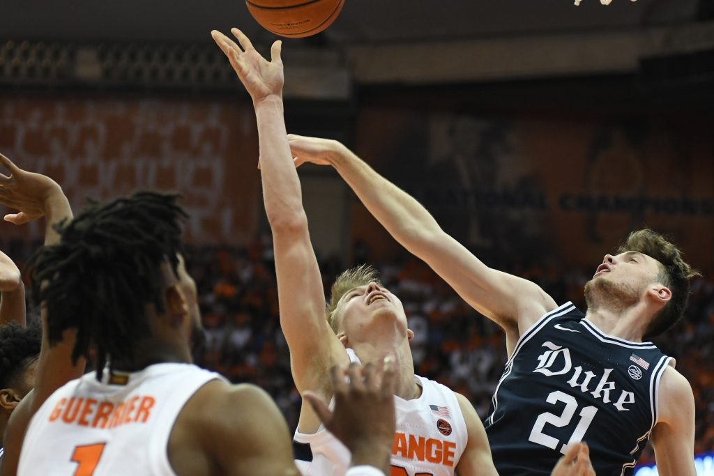 Marek Dolezaj attempts a shot over Duke's Matthew Hurt.