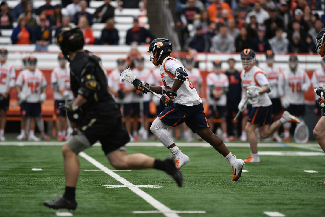 Syracuse's Dami Oladunmoye runs with the ball during the game at the Carrier Dome on Feb. 23, 2020.