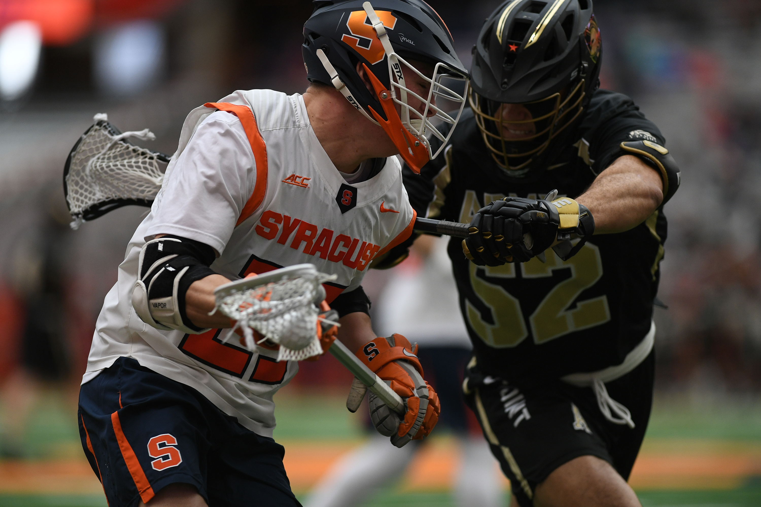 Syracuse's Tucker Dordevic tries to get around Army's Matthew Horace during the game at the Carrier Dome on Feb. 23, 2020.
