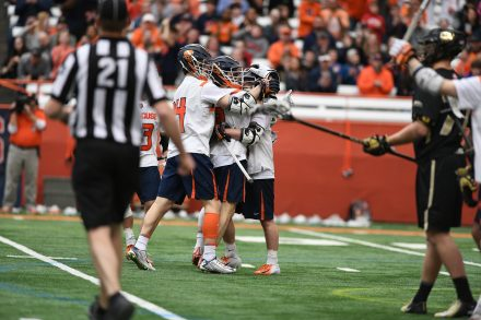 Syracuse players celebrate after Jamie Trimboli scores the go ahead goal during the game at the Carrier Dome on Feb. 23, 2020.