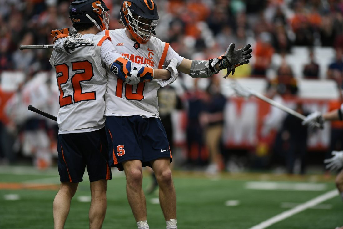 Brendan Curry and Chase Scanlan celebrate after Curry's goal late in the 4th period of the game at the Carrier Dome on Feb. 23, 2020.