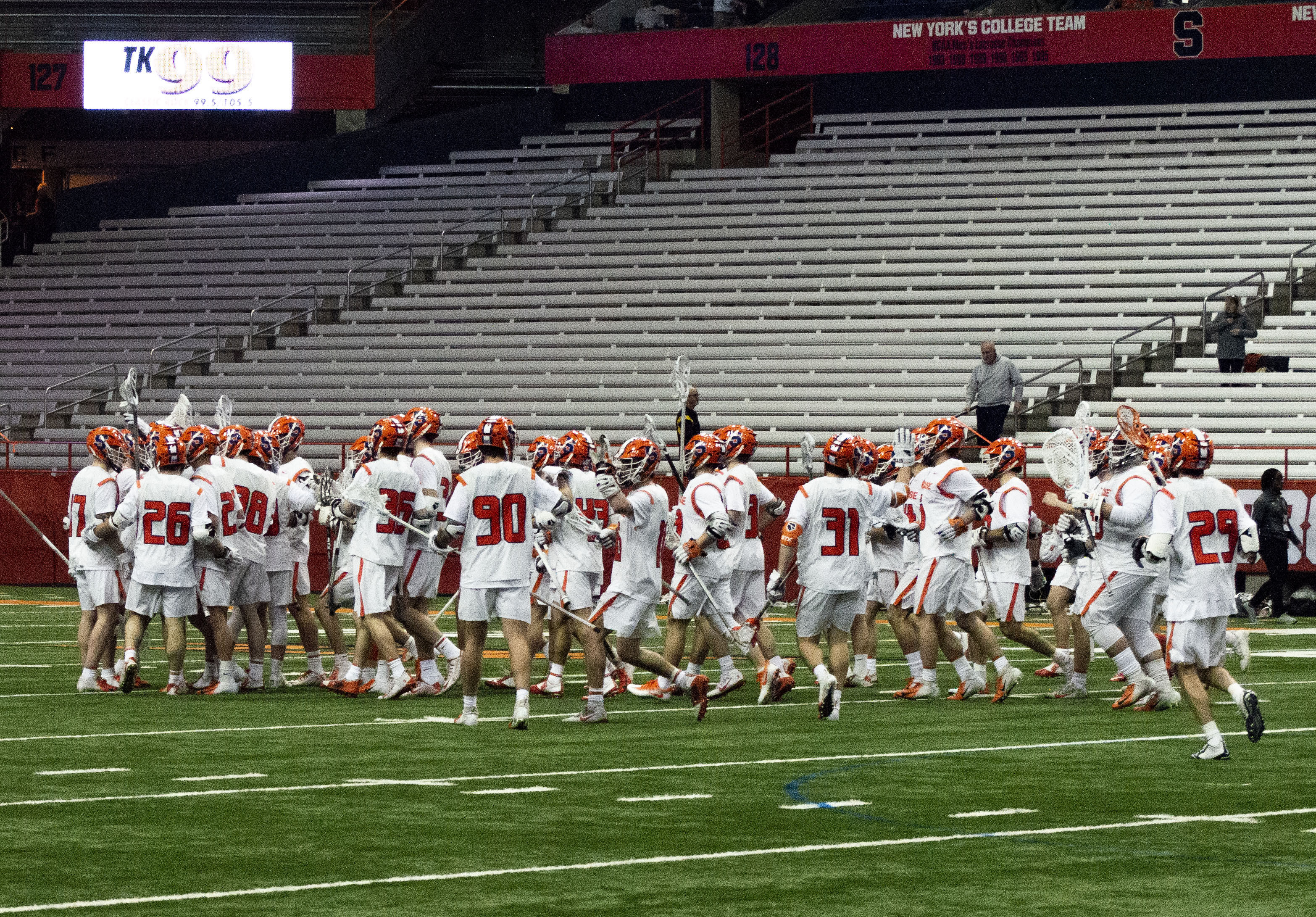 The Syracuse men's lacrosse team celebrates after winning their home opener versus Colgate 21-6 in the Carrier Dome.