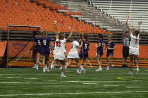 The Syracuse Women's Lacrosse team celebrate after a goal during Saturday's game vs. Albany in the Carrier Dome.