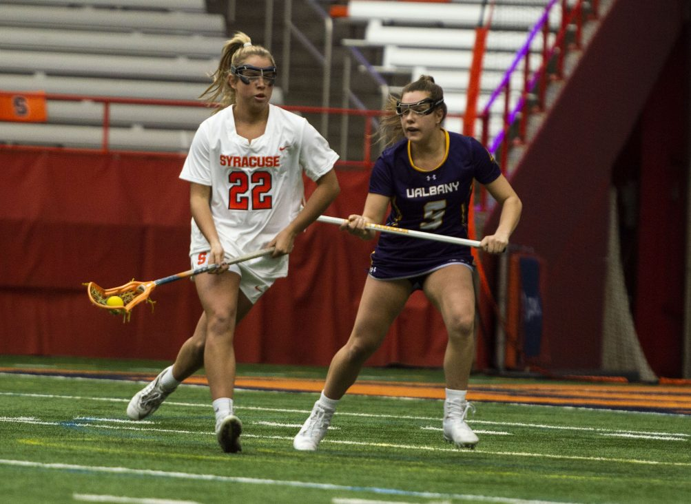 Megan Carney looks to a teammate as Albany's Kyla Zapolski defends during Saturday's game in the Carrier Dome.