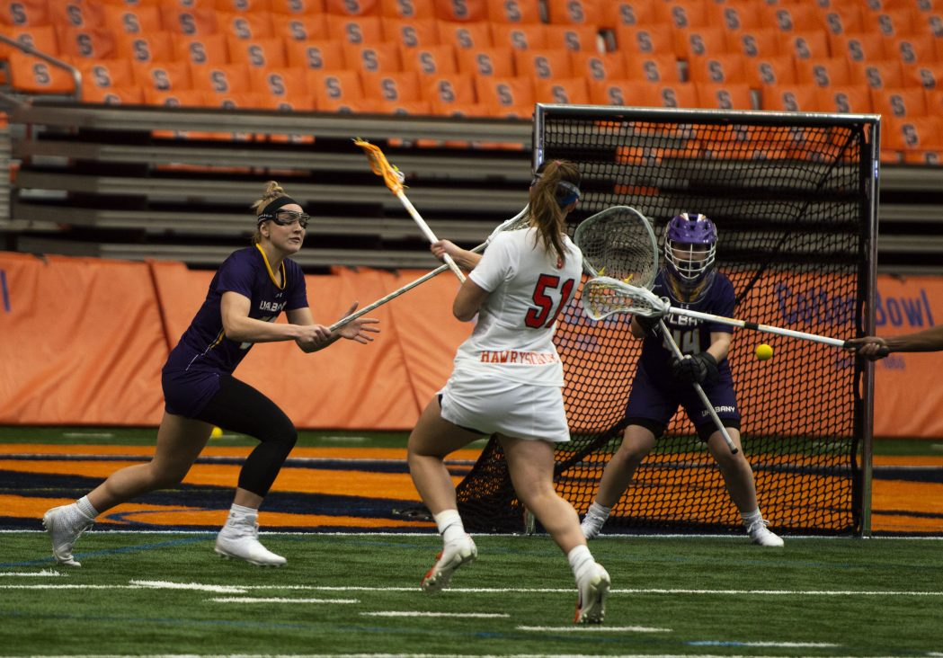Emily Hawryschuk shoots during Saturday's game vs. Albany in the Carrier Dome.