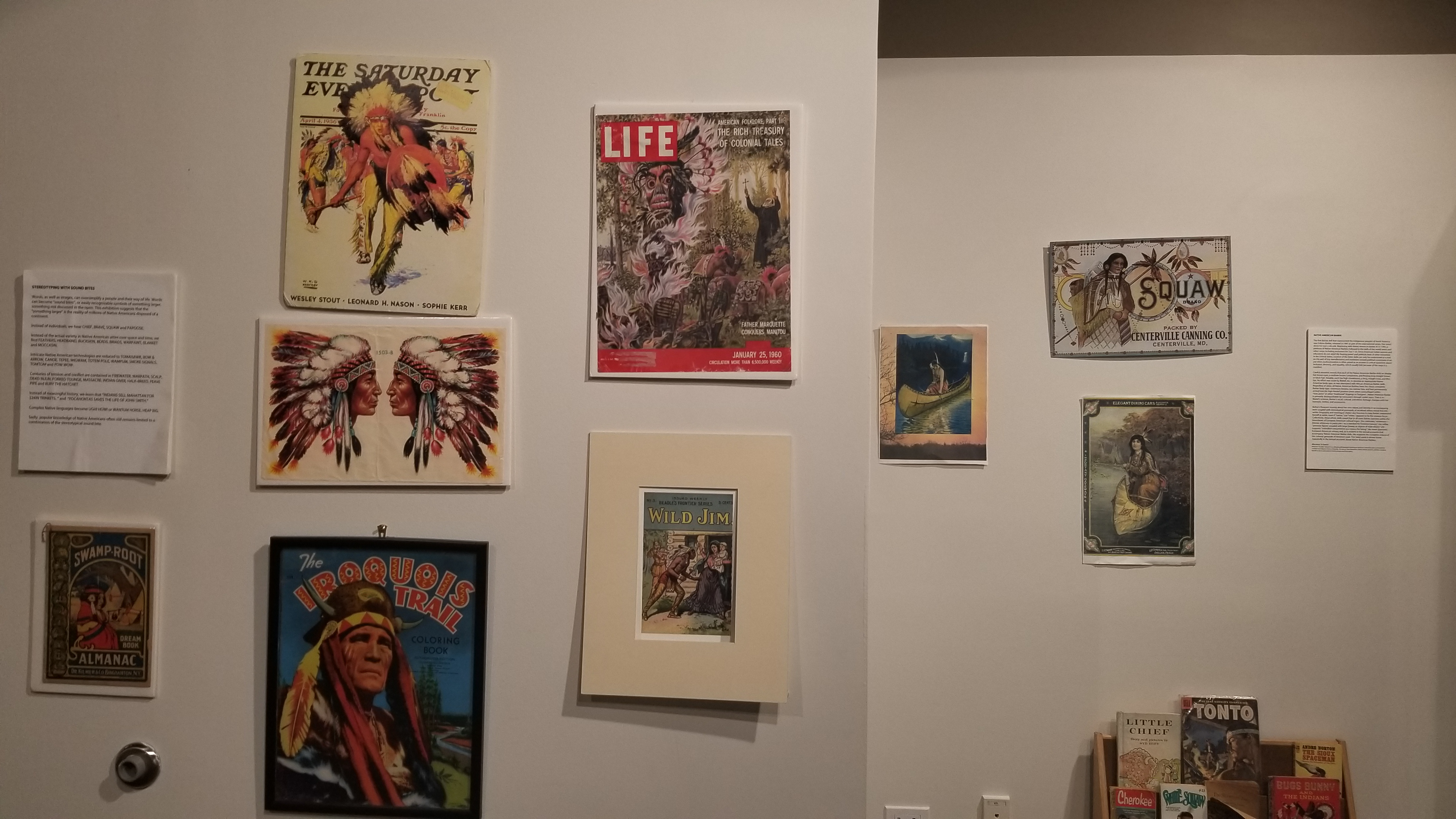 "Mainstream Native American imagery displayed on the walls of the ""Tonto Revisited"" exhibit."