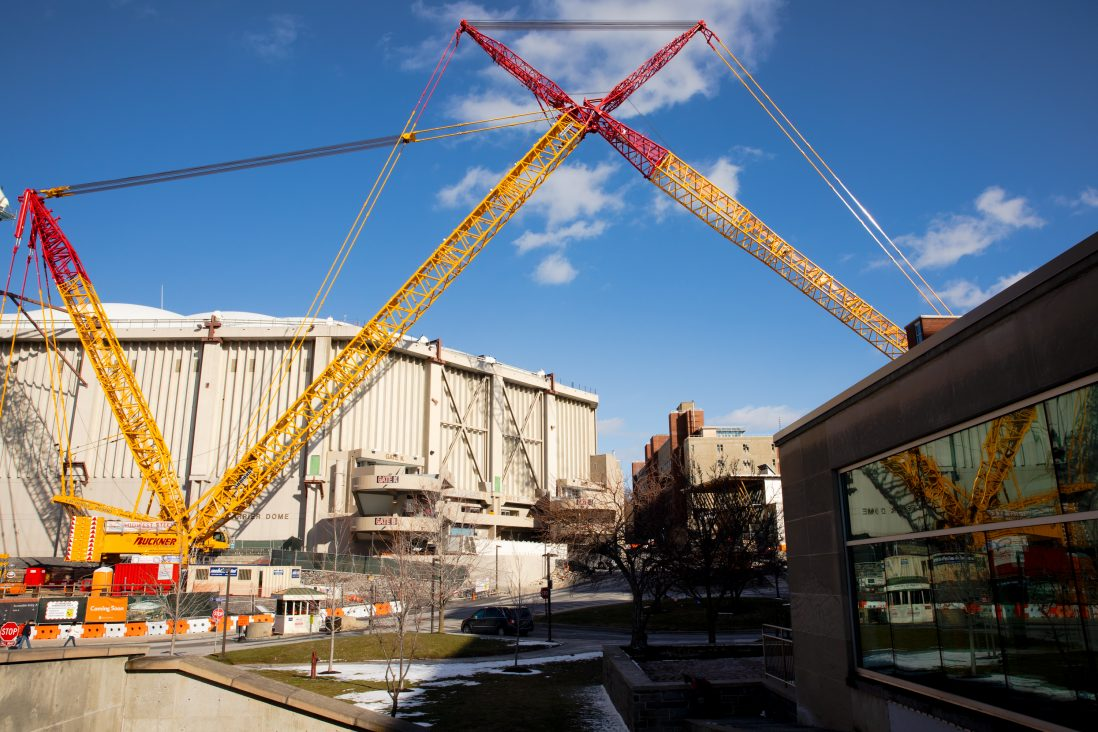 Cranes outside the Carrier Dome on Sunday March 1, 2020, during the last live event for the roof and renovation projects.