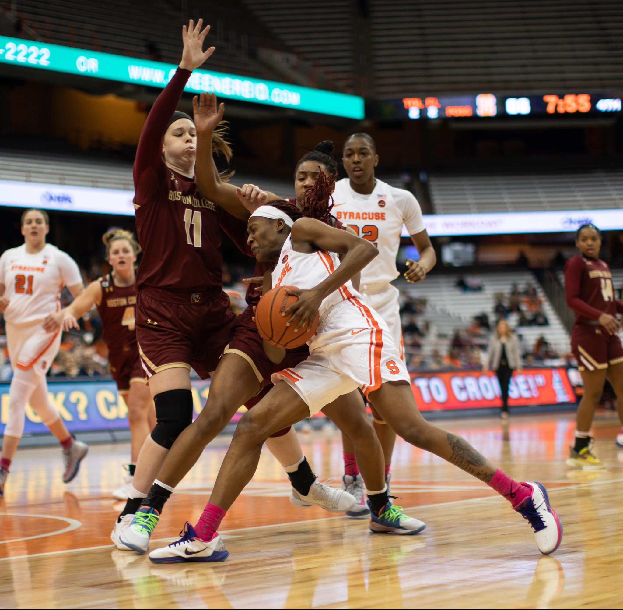 Gabrielle Cooper dives into defense as she goes in for a lay up against Boston College's Emma Guy defends.