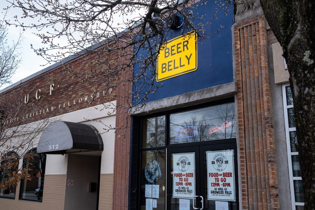 Beer Belly Deli on Westcott street remains open to serve takeout and delivery. This is a favorite of many Syracuse University students. Westcott street is also very empty.