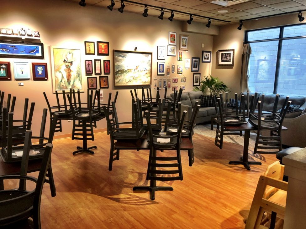 Chairs stacked on tables inside Saratoga Deli