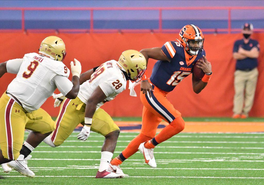 Nov 7, 2020; Syracuse, New York, USA; Syracuse Orange quarterback JaCobian Morgan (15) runs from Boston College Eagles linebacker John Lamot (28) and defensive tackle Chibueze Onwuka (9) in the second quarter at the Carrier Dome. Mandatory Credit: Mark Konezny-USA TODAY Sports