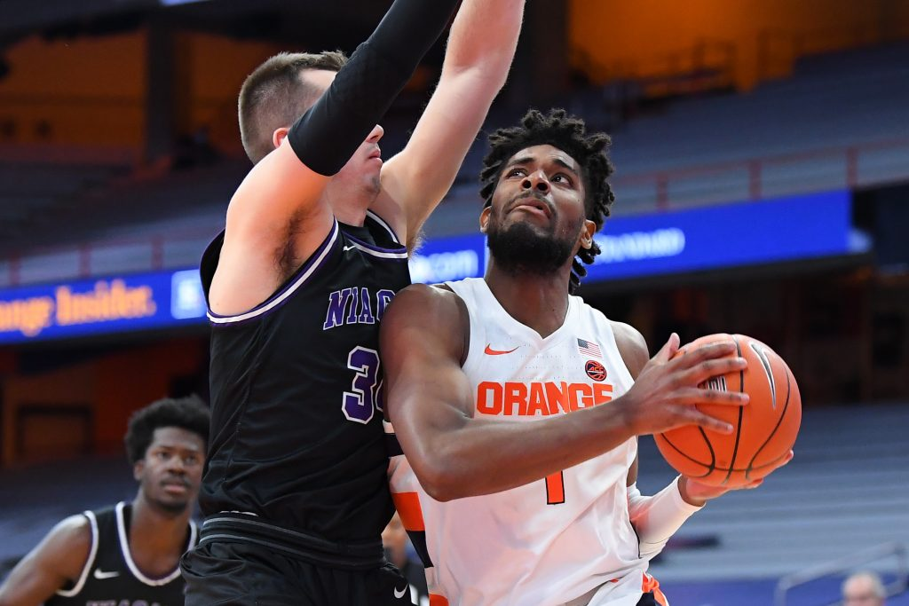 Syracuse Orange forward Quincy Guerrier (1) drives to the basket against the defense of Niagara