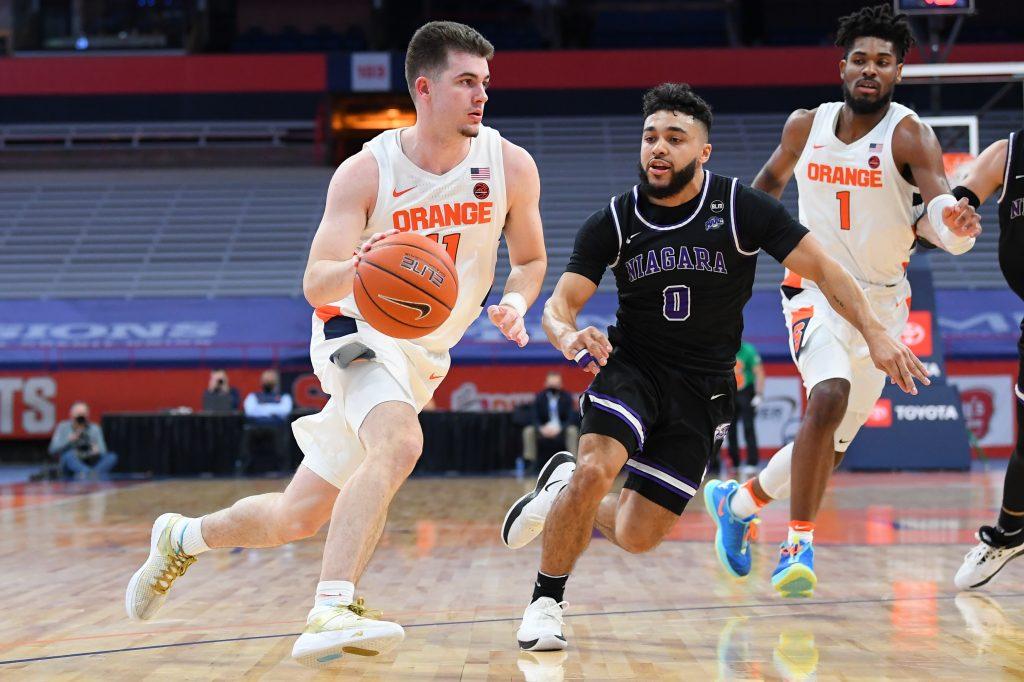 Syracuse Orange guard Joseph Girard III (11) drives to the basket as Niagara
