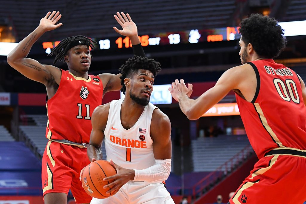 Dec 16, 2020; Syracuse, New York, USA; Syracuse Orange forward Quincy Guerrier (1) controls the ball between Northeastern Huskies guard Jahmyl Telfort (11) and forward Jason Strong (00) during the first half at the Carrier Dome. Mandatory Credit: Rich Barnes-USA TODAY Sports