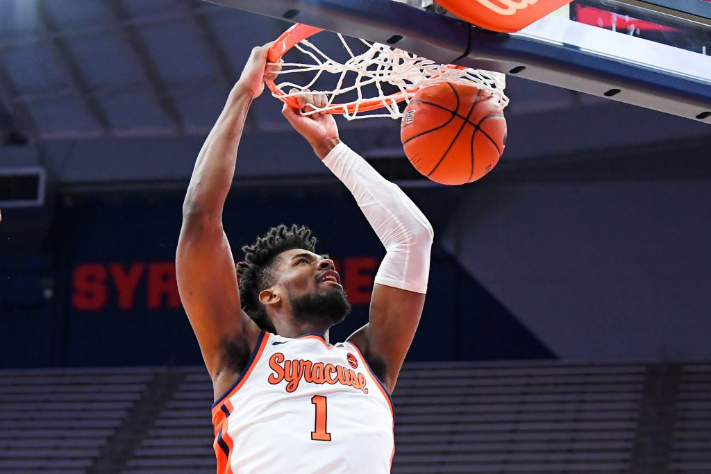Dec 19, 2020; Syracuse, New York, USA; Syracuse Orange forward Quincy Guerrier (1) dunks the ball against the Buffalo Bulls during the first half at the Carrier Dome. Mandatory Credit: Rich Barnes-USA TODAY Sports