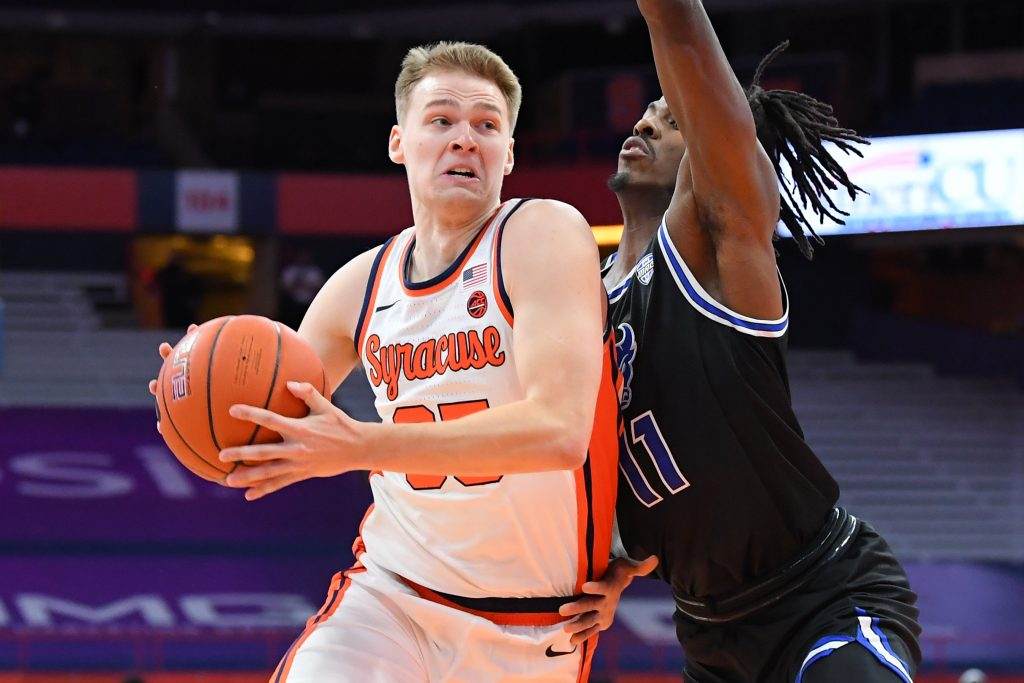 Dec 19, 2020; Syracuse, New York, USA; Syracuse Orange guard Buddy Boeheim (35) drives to the basket as Buffalo Bulls forward Jeenathan Williams (11) defends during the first half at the Carrier Dome. Mandatory Credit: Rich Barnes-USA TODAY Sports
