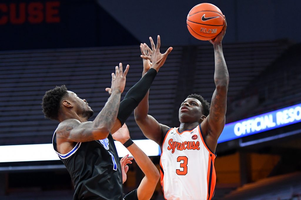 Dec 19, 2020; Syracuse, New York, USA; Syracuse Orange forward Kadary Richmond (3) shoots the ball as Buffalo Bulls forward LaQuill Hardnett (1) defends during the first half at the Carrier Dome. Mandatory Credit: Rich Barnes-USA TODAY Sports