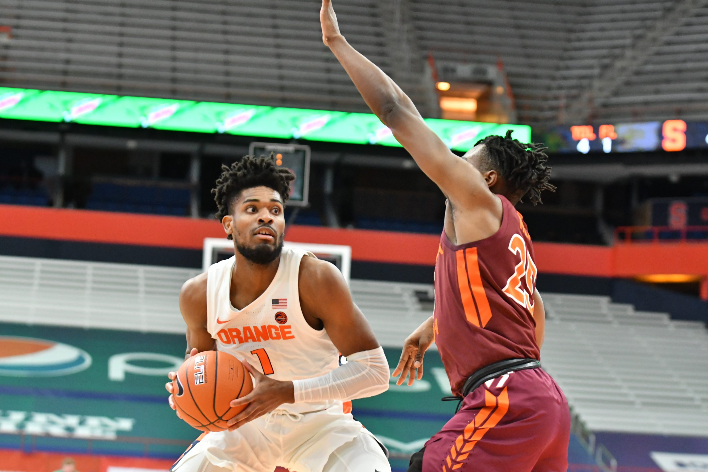 Jan 23, 2021; Syracuse, New York, USA; Syracuse Orange forward Quincy Guerrier (1) tries to move past Virginia Tech Hokies forward Justyn Mutts (25) in the first half at the Carrier Dome. Mandatory Credit: Mark Konezny-USA TODAY Sports