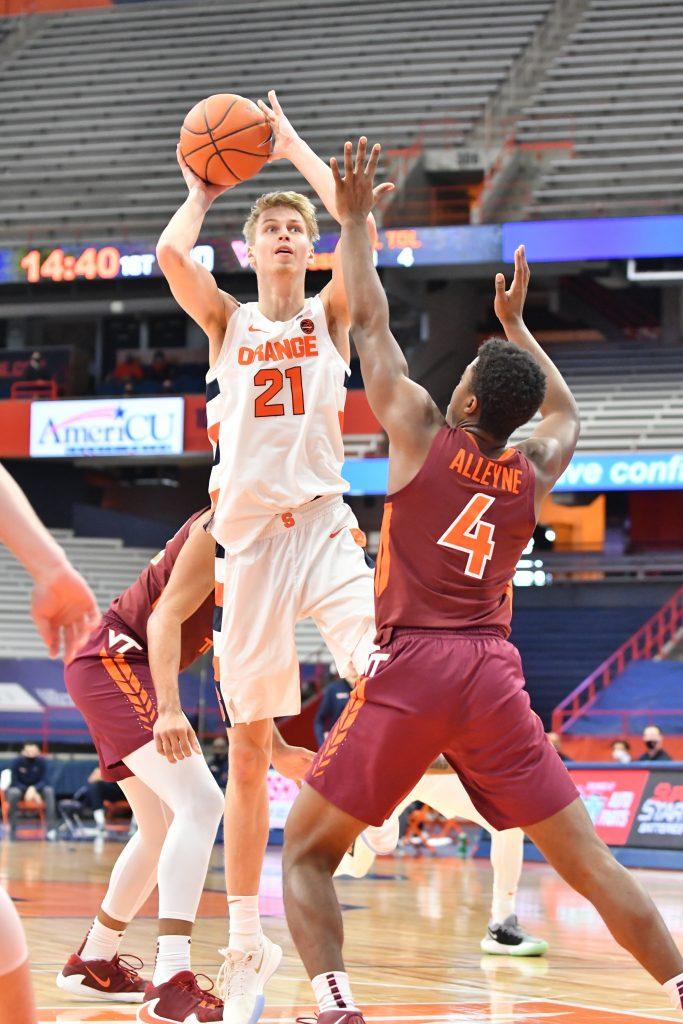 Jan 23, 2021; Syracuse, New York, USA; Syracuse Orange forward Marek Dolezaj (21) shoots over Virginia Tech Hokies guard Nahiem Alleyne (4) in the first half at the Carrier Dome. Mandatory Credit: Mark Konezny-USA TODAY Sports