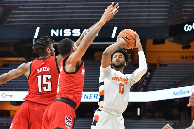 Jan 31, 2021; Syracuse, New York, USA; Syracuse Orange forward Alan Griffin (0) looks to pass the ball as North Carolina State Wolfpack forward Manny Bates (15) and guard Shakeel Moore (2) defend in the first half at the Carrier Dome. Mandatory Credit: Mark Konezny-USA TODAY Sports