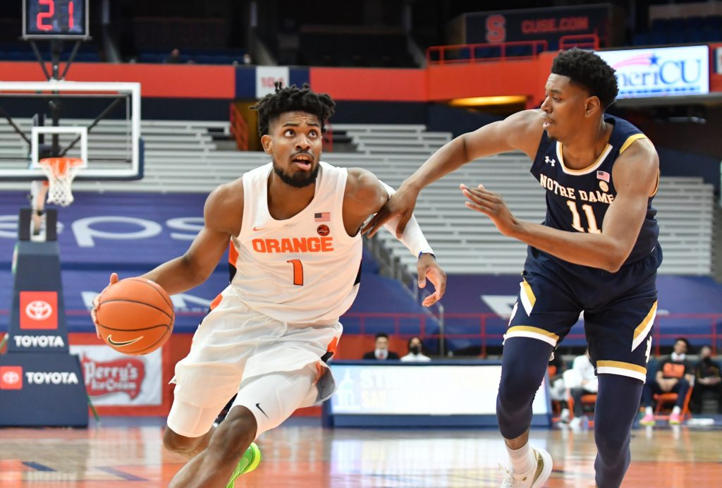 Syracuse Orange forward Quincy Guerrier (1) drives the ball as Notre Dame Fighting Irish forward Juwan Durham (11) defends in the first half at the Carrier Dome.