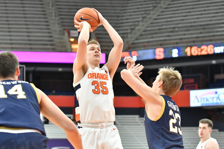 Syracuse Orange guard Buddy Boeheim (35) takes a shot over Notre Dame Fighting Irish guard Dane Goodwin (23) in the first half at the Carrier Dome.
