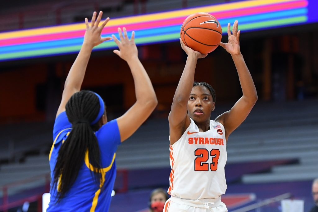 Jan 28, 2021; Syracuse, New York, USA; Syracuse Orange guard Kiara Lewis (23) shoots the ball against the defense of Pittsburgh Panthers guard Dayshanette Harris (1) during the first half at the Carrier Dome. Mandatory Credit: Rich Barnes-USA TODAY Sports